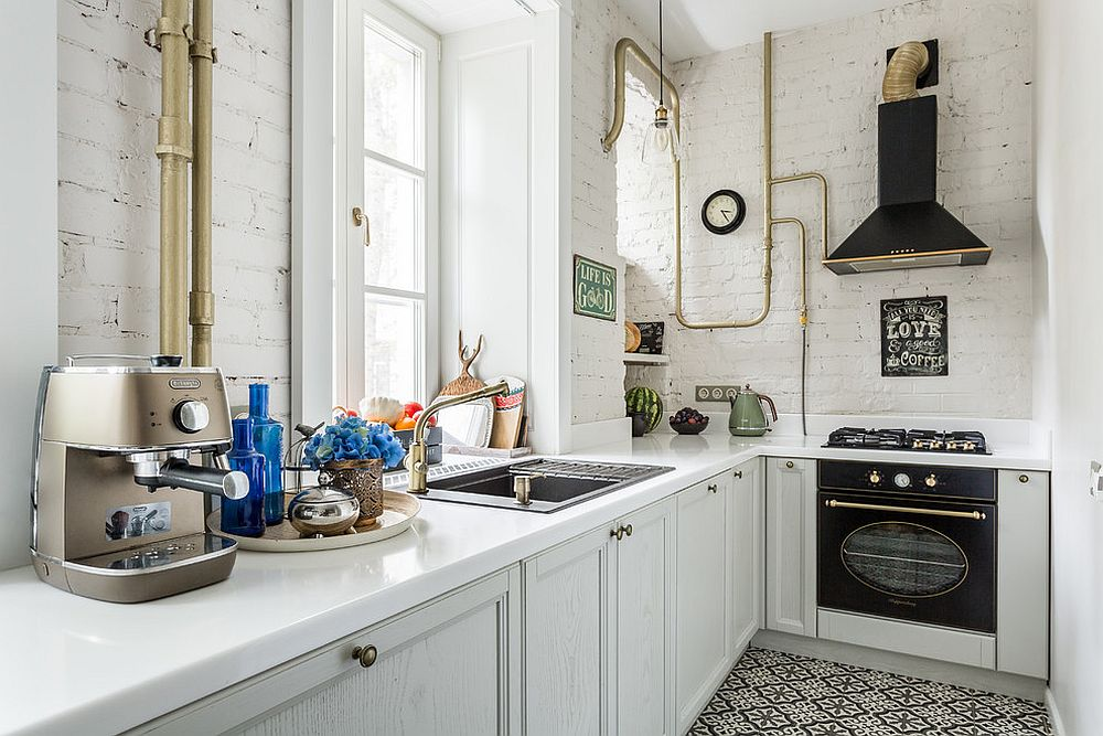 Brick painted in white brings timeless charm to the small industrial kitchen with black thrown into the mix