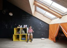 Ceiling-windows-bring-ample-light-in-to-the-kids-playroom-with-chalkboard-wall-217x155