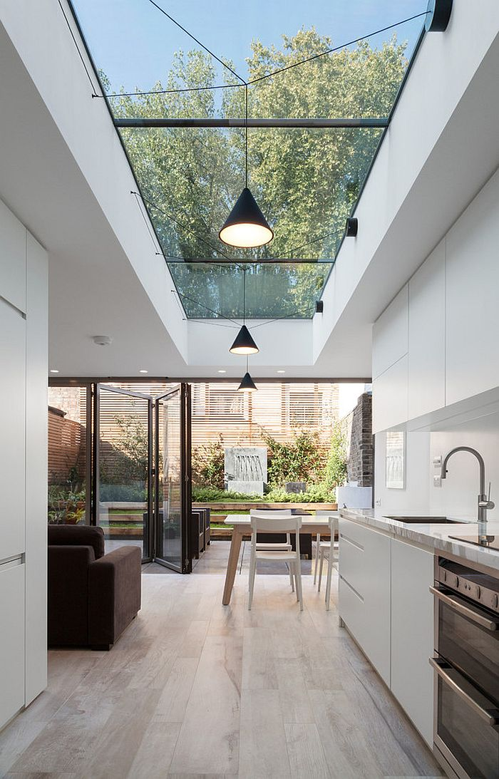 Ceiling windows bring the outdoors inside to give the kitchen a spacious appeal