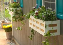 Charming-DIY-wooden-flower-box-by-the-window-is-a-showstopper-217x155
