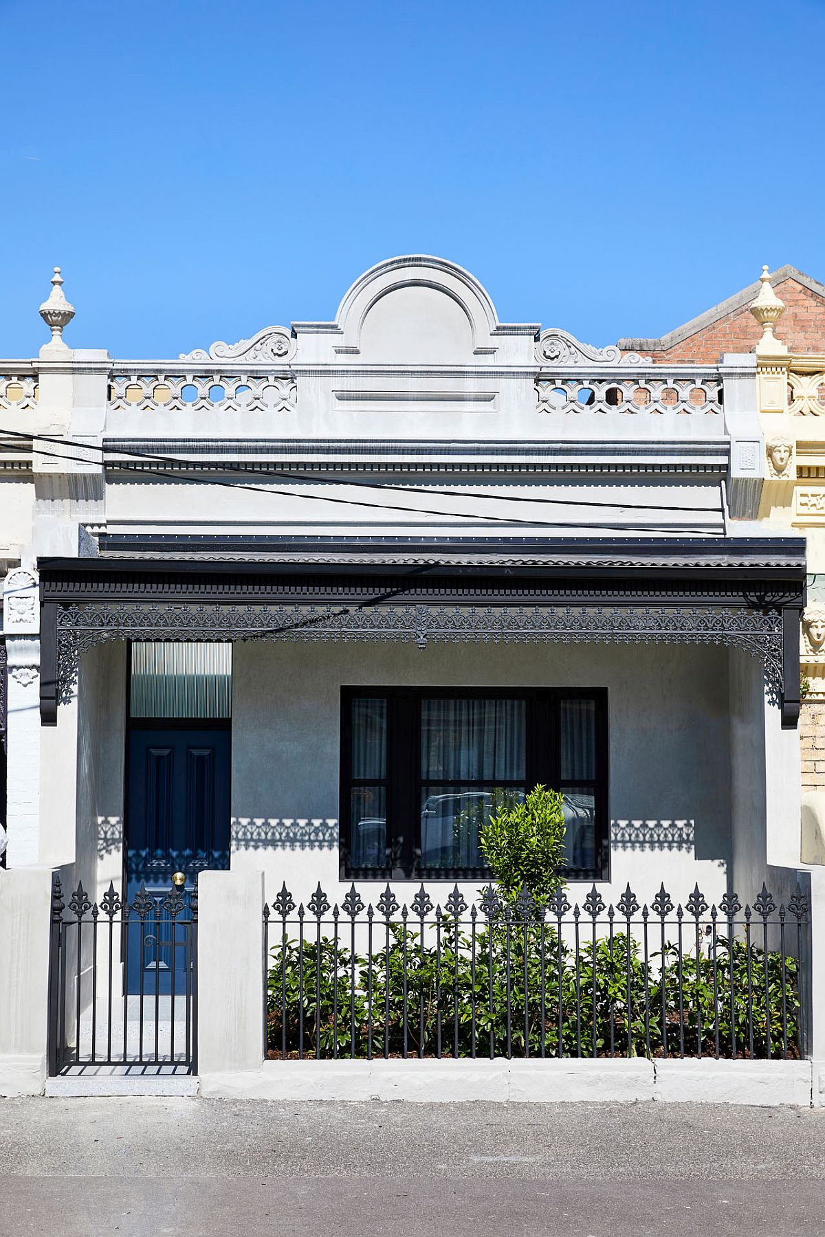 Classic street facade of the Victorian style Melbourne home with Italianate-style terrace
