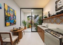 Colorful-tiled-backsplash-and-art-piece-bring-Mexican-flavor-to-the-kitchen-217x155