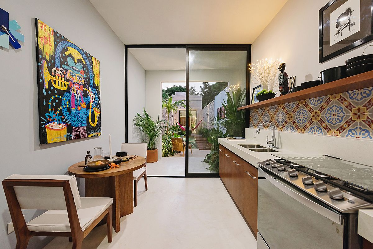 Colorful-tiled-backsplash-and-art-piece-bring-Mexican-flavor-to-the-kitchen