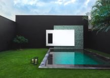 Contemporary-backyard-design-with-a-poolscape-that-matches-the-setting-217x155