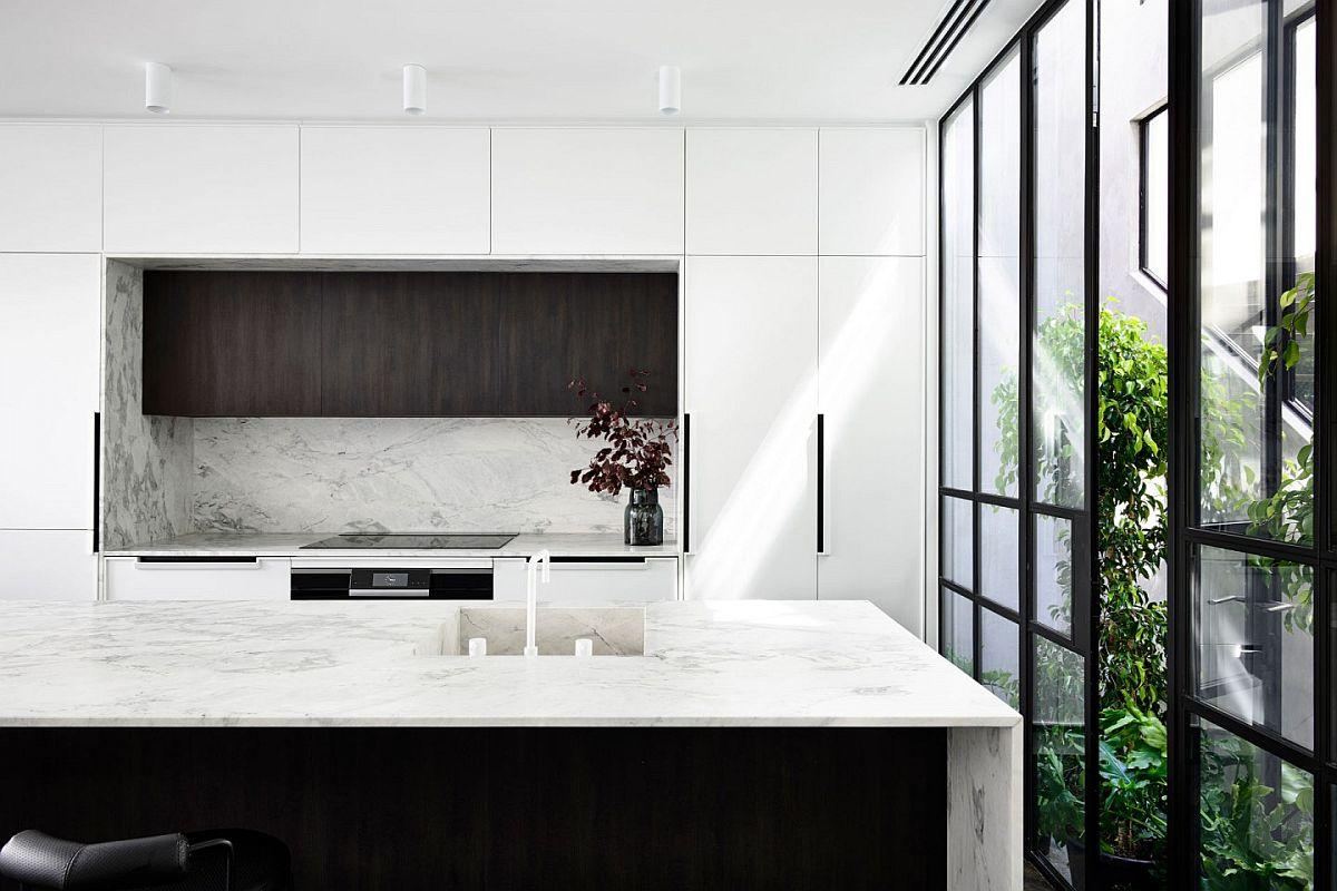 Contemporary kitchen in black and white with framed glass walls