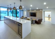 Contemporary-kitchen-on-the-suburban-home-in-white-with-a-spacious-island-217x155