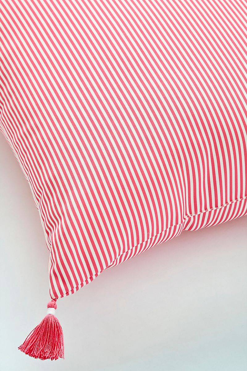 Coral striped throw pillow with tassels