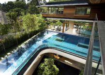 Curved-swimming-pool-on-the-upper-level-with-garden-below-217x155