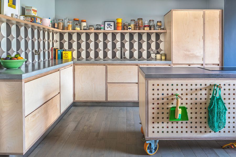 Custom kitchen island on wheels with pegboard offers multiple storage options