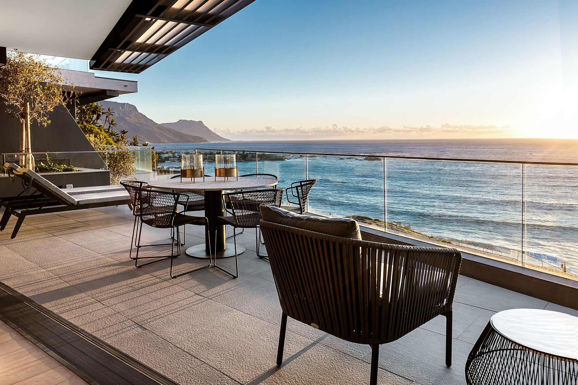 Custom-tables-in-black-granite-along-with-comfy-chairs-for-the-amazing-balcony-with-ocean-views