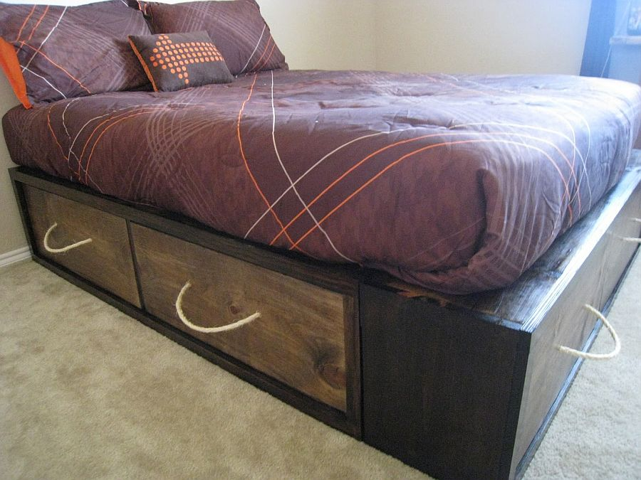 DIY wooden crates crafted from reclaimed wood adds storage space to bed