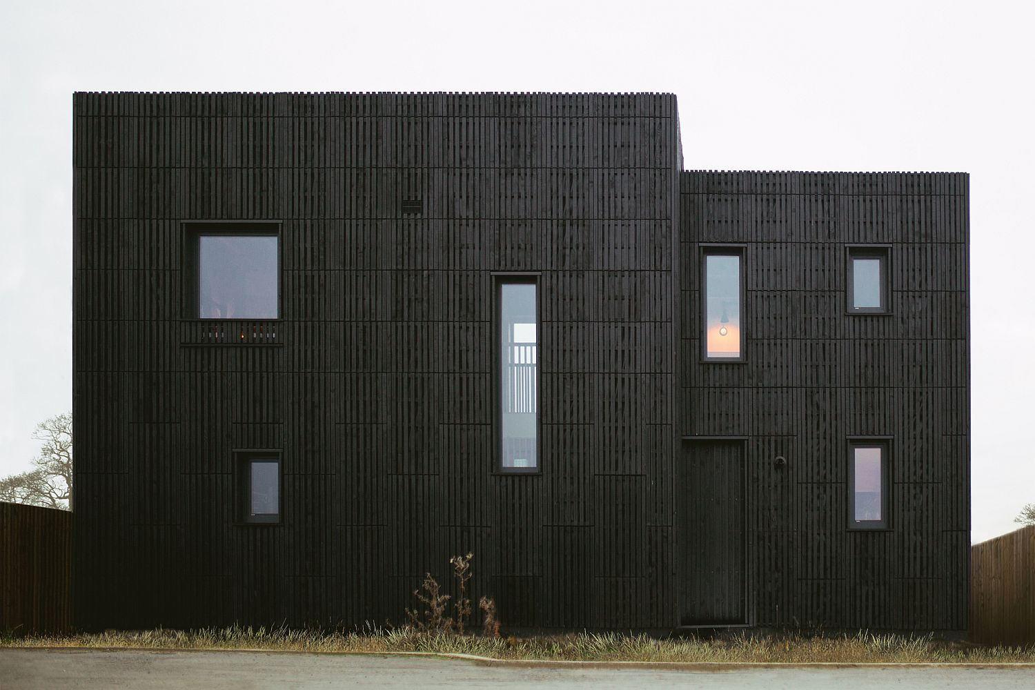 Dark, box-shaped exterior of the house in Bicester