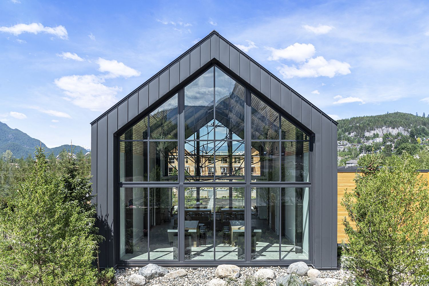 Dark-metal-panels-along-with-glass-create-a-delightful-gable-design