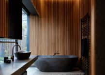 Dark-wood-and-natural-stone-elements-give-the-bathroom-a-stunning-visual-appeal-217x155