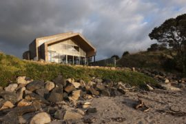 Weathered Steel and Wood Home on Ocean's Edge Inspired by Life on the High Seas!