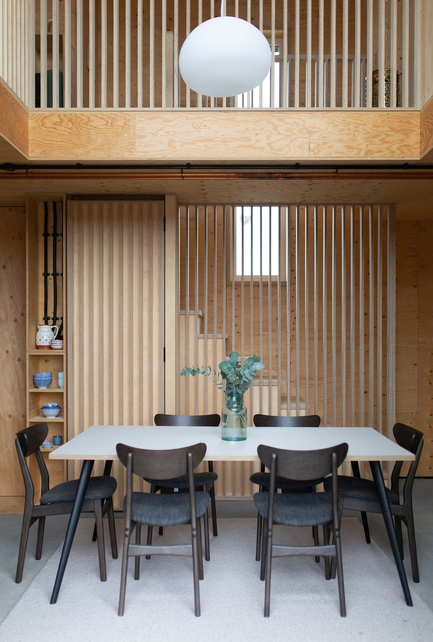 Double-height dining area of the Box House