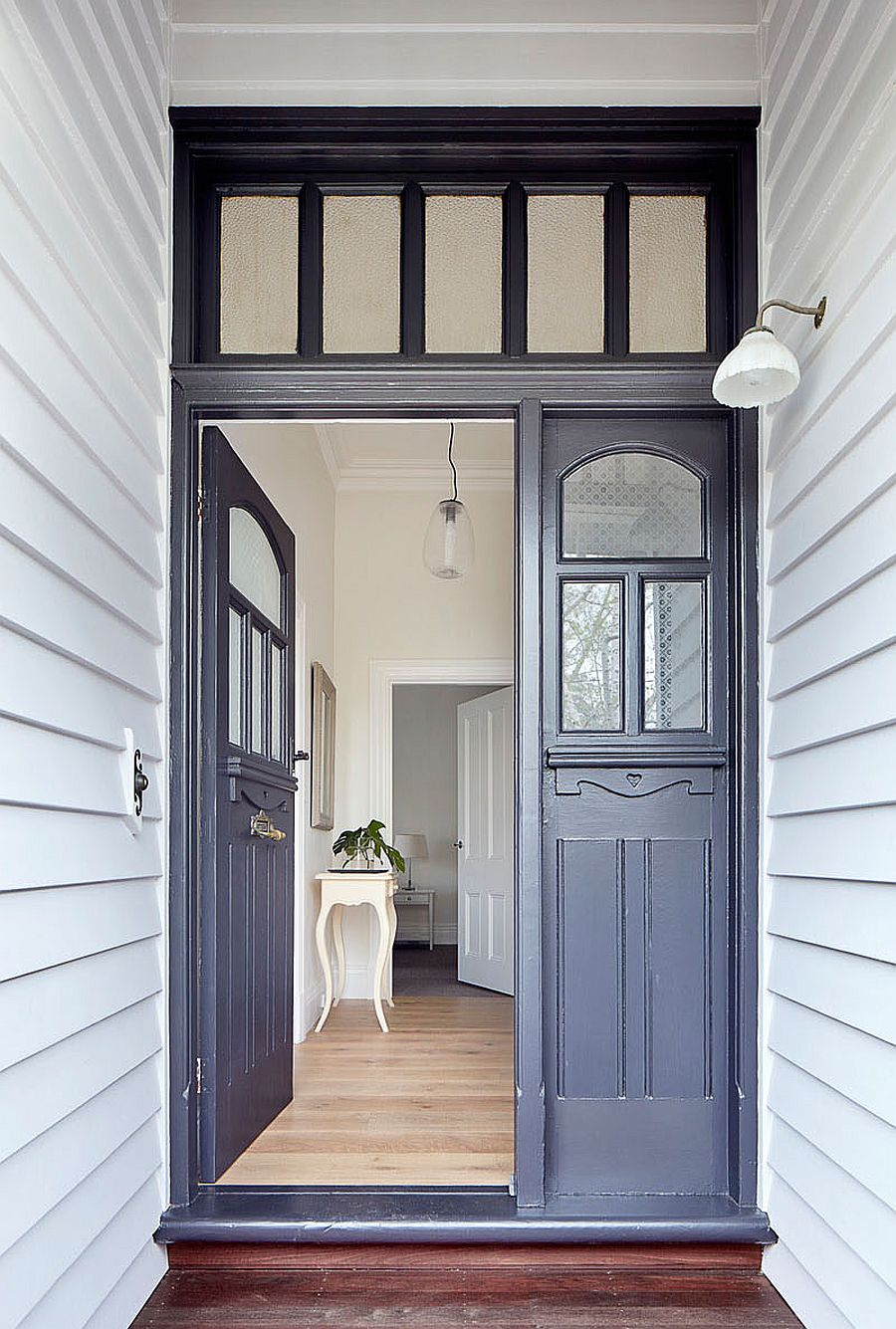 Entry to the traditional home with modern gray doors