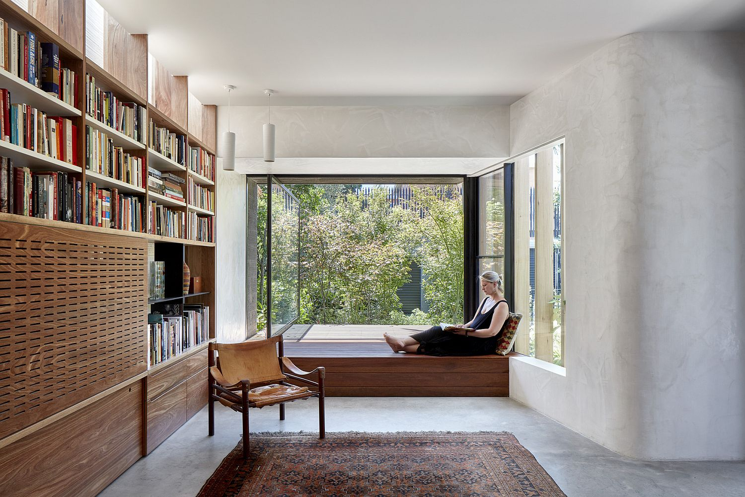Fabulous little window seat with wall of books on the other side for a relaxing reading area