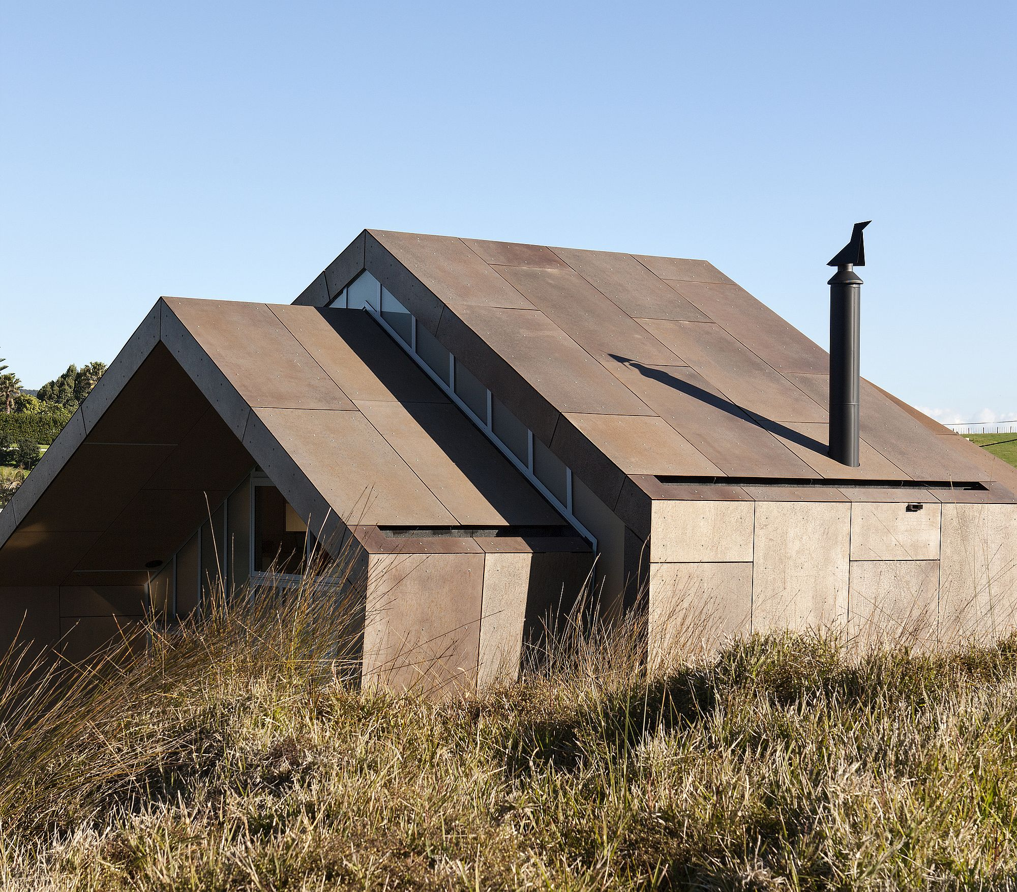 Fabulous weathered panels of the house allow it to blend in with the landscape