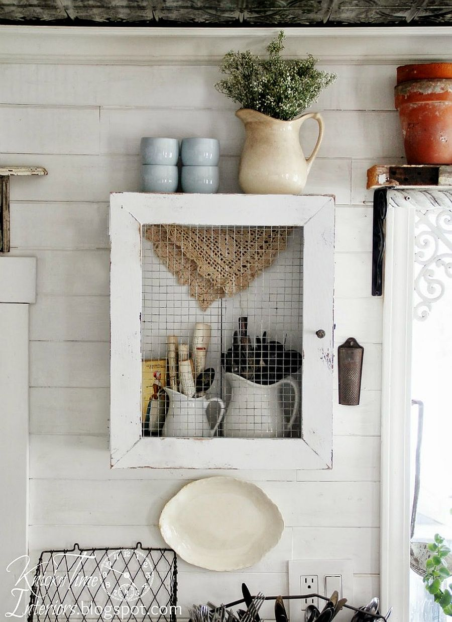 Farmhouse style wall cabinet made from reclaimed wood and chicken wire is a showstopper!
