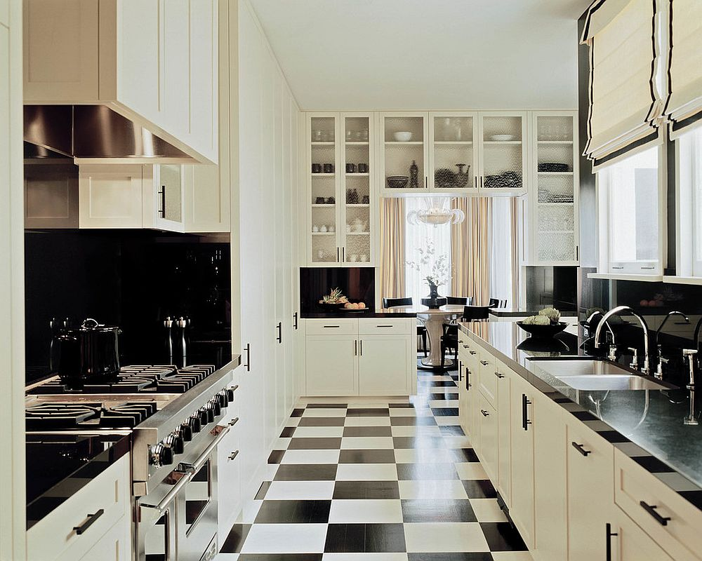 Floor tiles add to the black and white color scheme of the kitchen