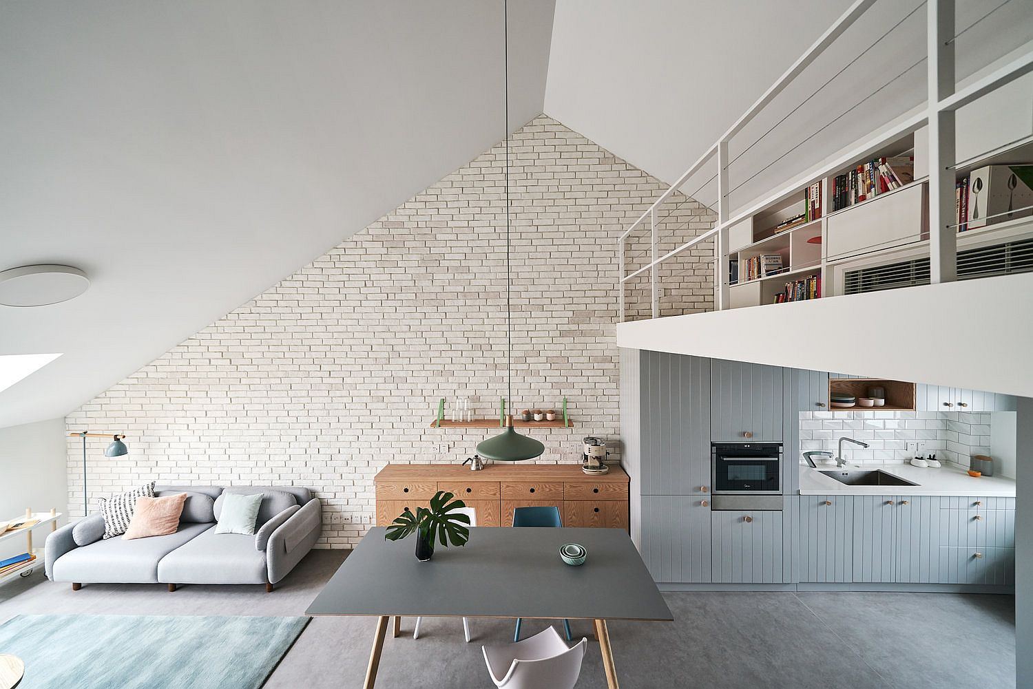 Gorgeous and space-conscious apartment design with mezzanine level bedroom