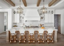 Gorgeous-farmhouse-style-kitchen-in-wood-and-white-with-bar-stools-that-match-the-setting-217x155