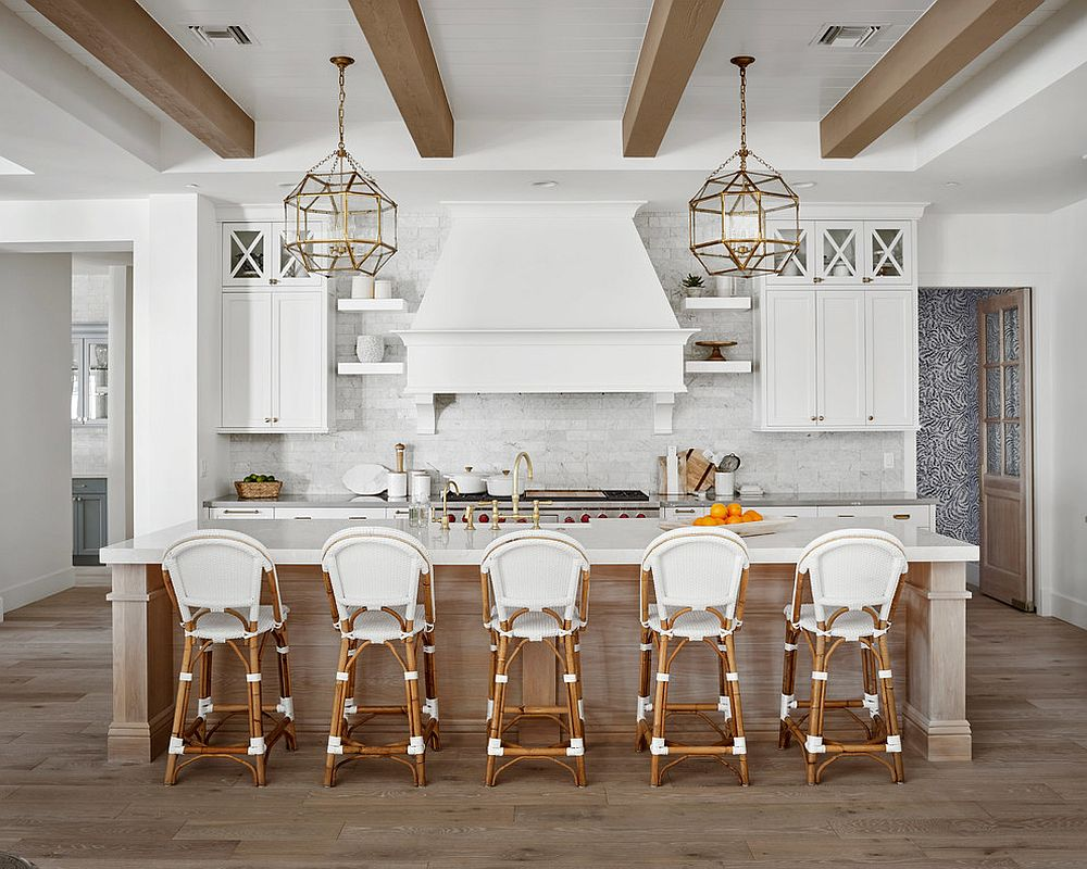 Gorgeous farmhouse style kitchen in wood and white with bar stools that match the setting