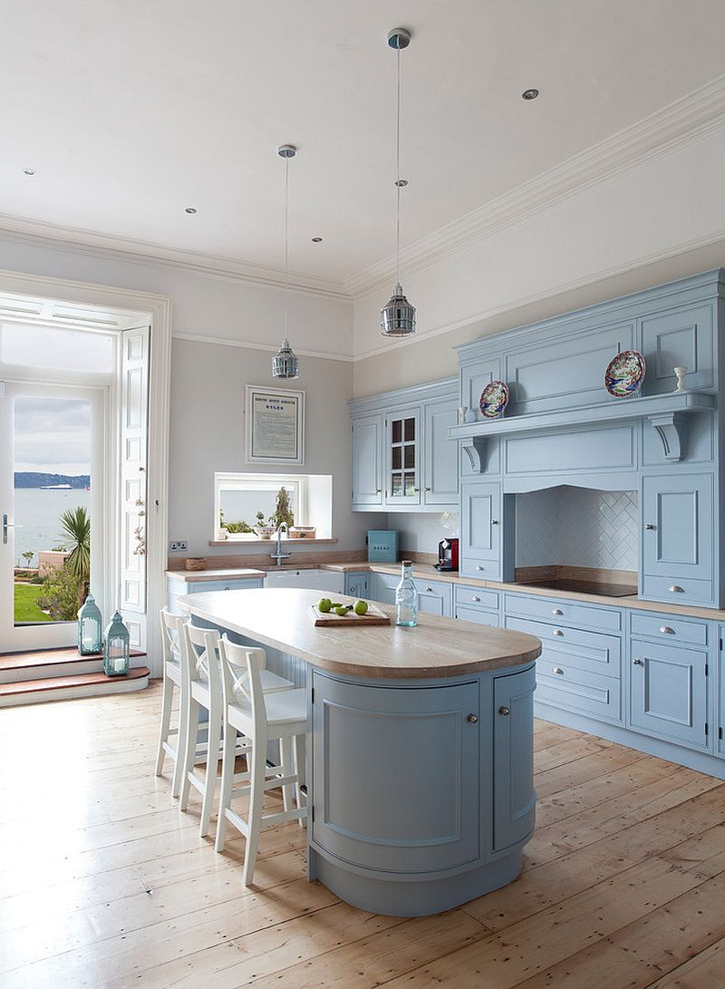 Gorgeous farmhouse style kitchen with light blue cabinets and island