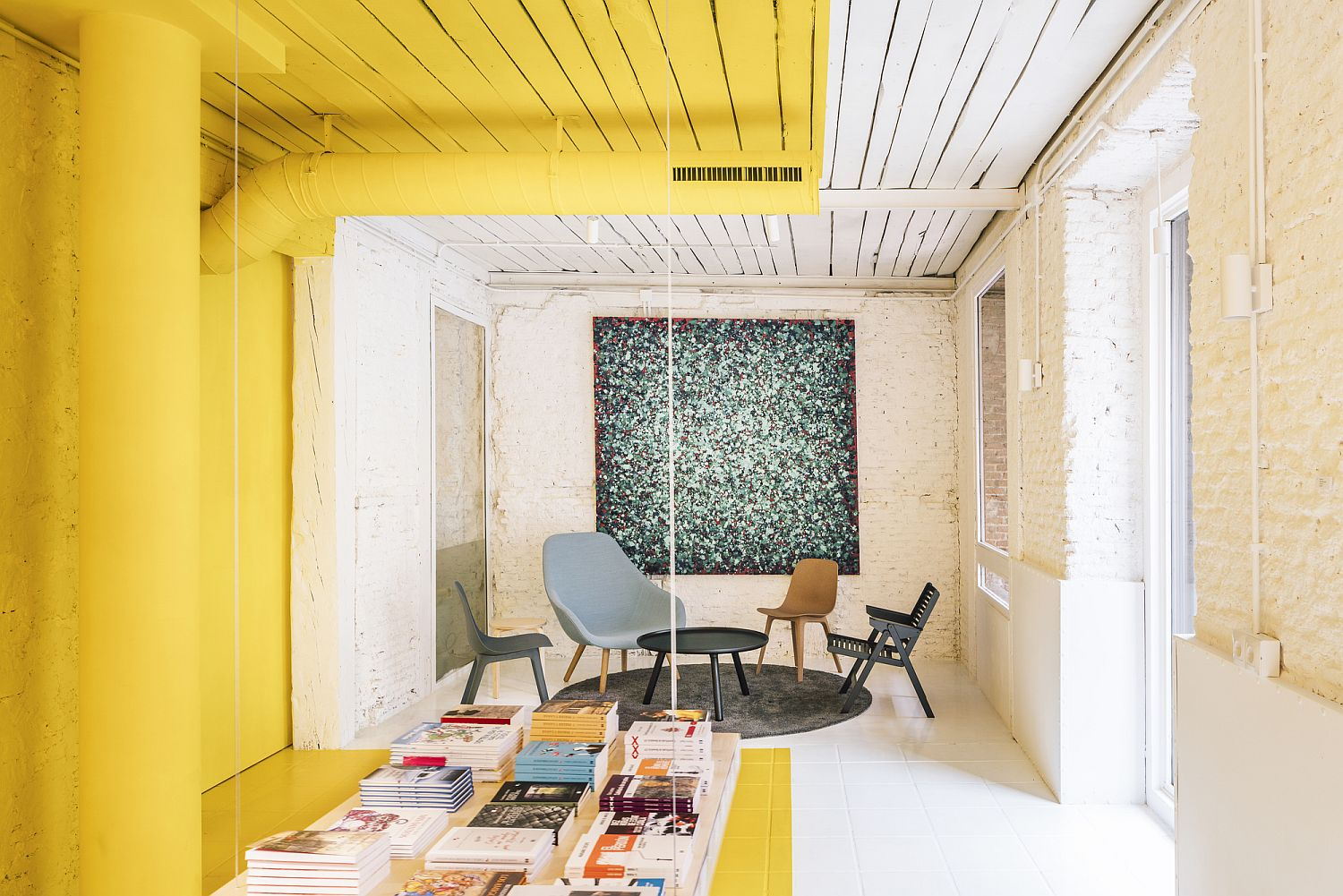Gorgeous use of yellow inside the office steals the spotlight
