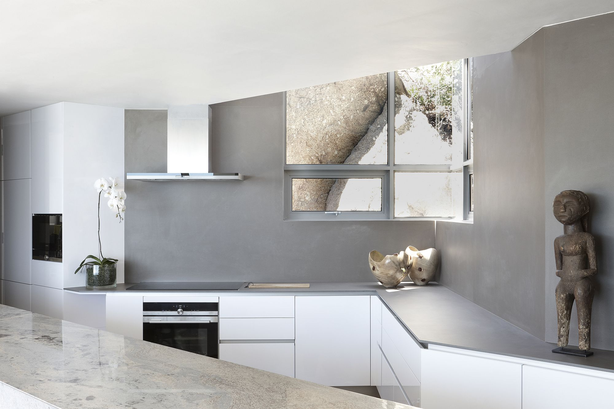 Gray and white contemporary kitchen with a view of the outdoors