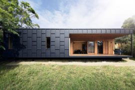 Plywood Warmth Meets Dark Metallic Magic at this Cost-Effective Aussie Home