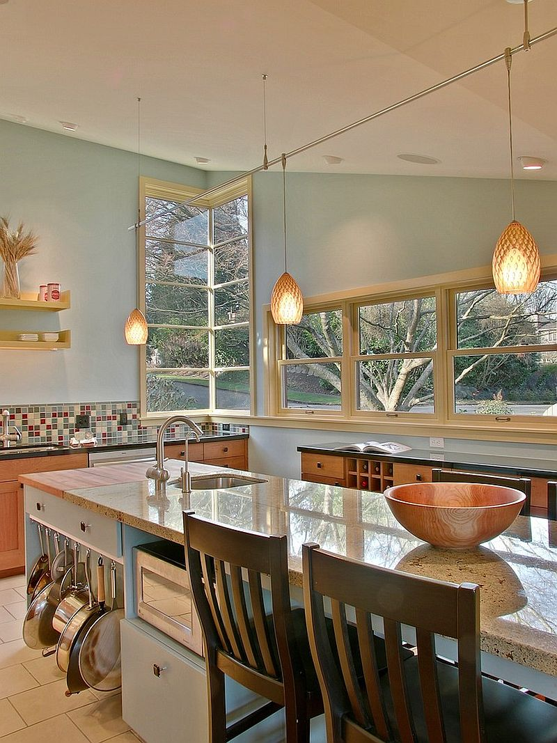 Hanging the pots and pans at the side of the kitchen island to save space