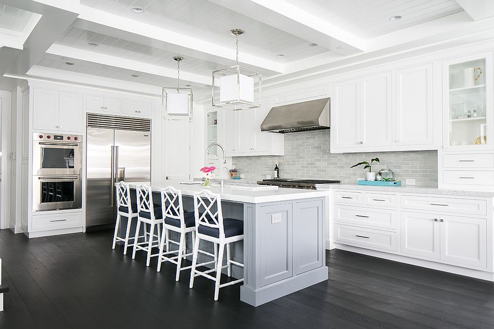 It is flooring and tiles that add gray to the white kitchen