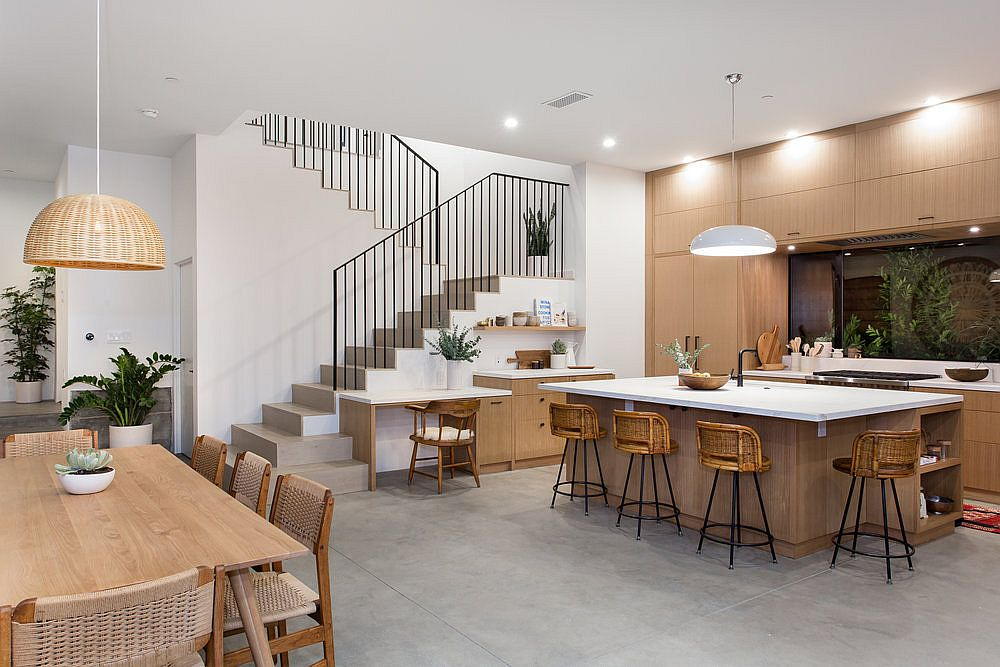 Kitchen here feels like an extension of the living area in white and wood