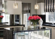 Kitchen-island-with-a-mirrored-finish-is-a-showstopper-indeed-217x155