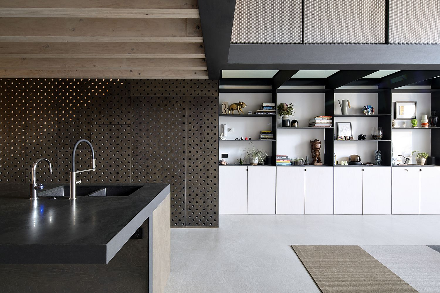 Kitchen matches the industrila minimal appeal of the house