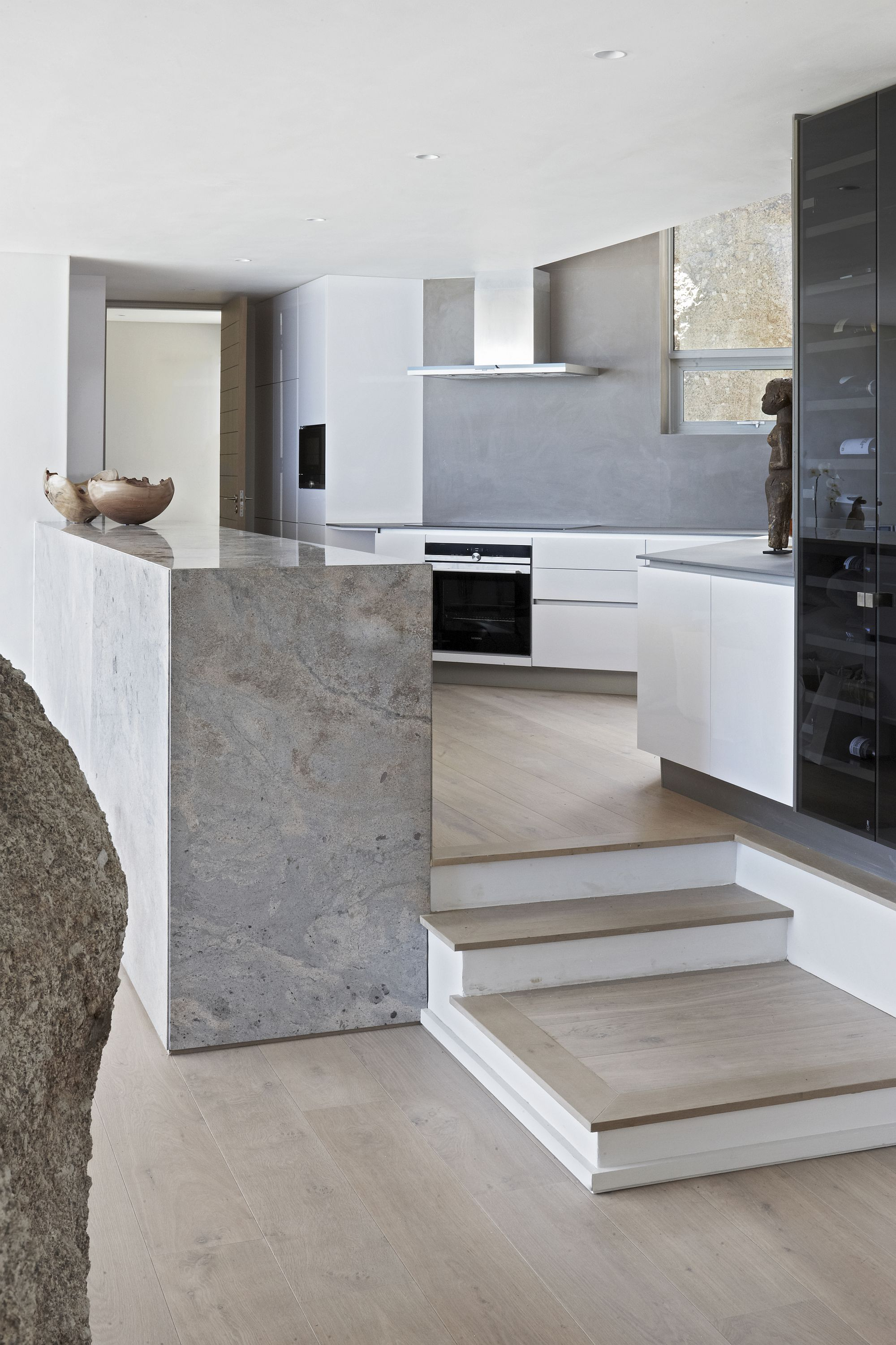 Kitchen on an elevated level gives the interior more curated look