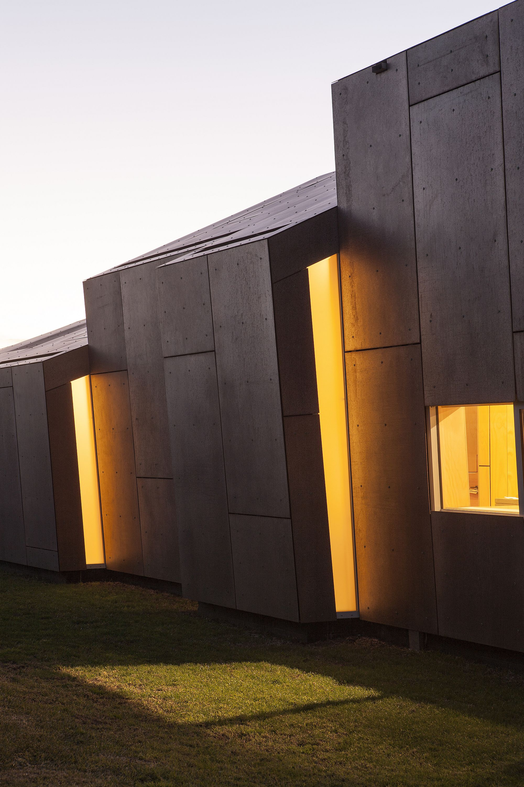Lighting brings another layer intrigue to the facade of the Fe304 House