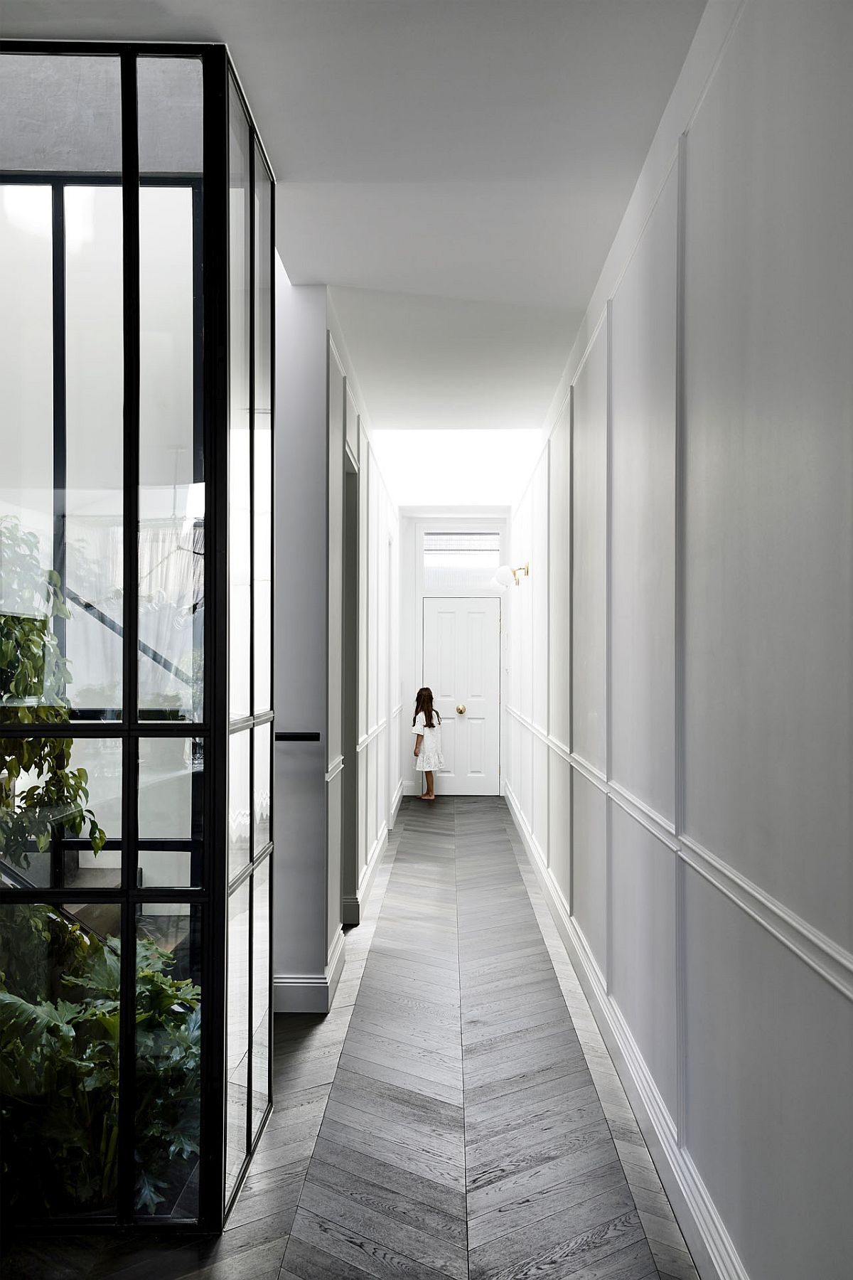 Long corridor and atrium welcome you at this Melbourne house