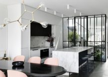 Marble-along-with-metallic-pendant-fixture-brings-polished-elegance-to-the-interior-217x155