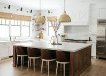Metallics-and-bar-stools-alter-the-appeal-of-the-wood-and-white-kitchen-217x155