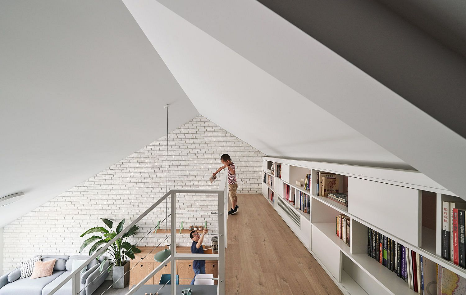 Mezzanine-level-bookshelf-makes-use-of-space-with-ease