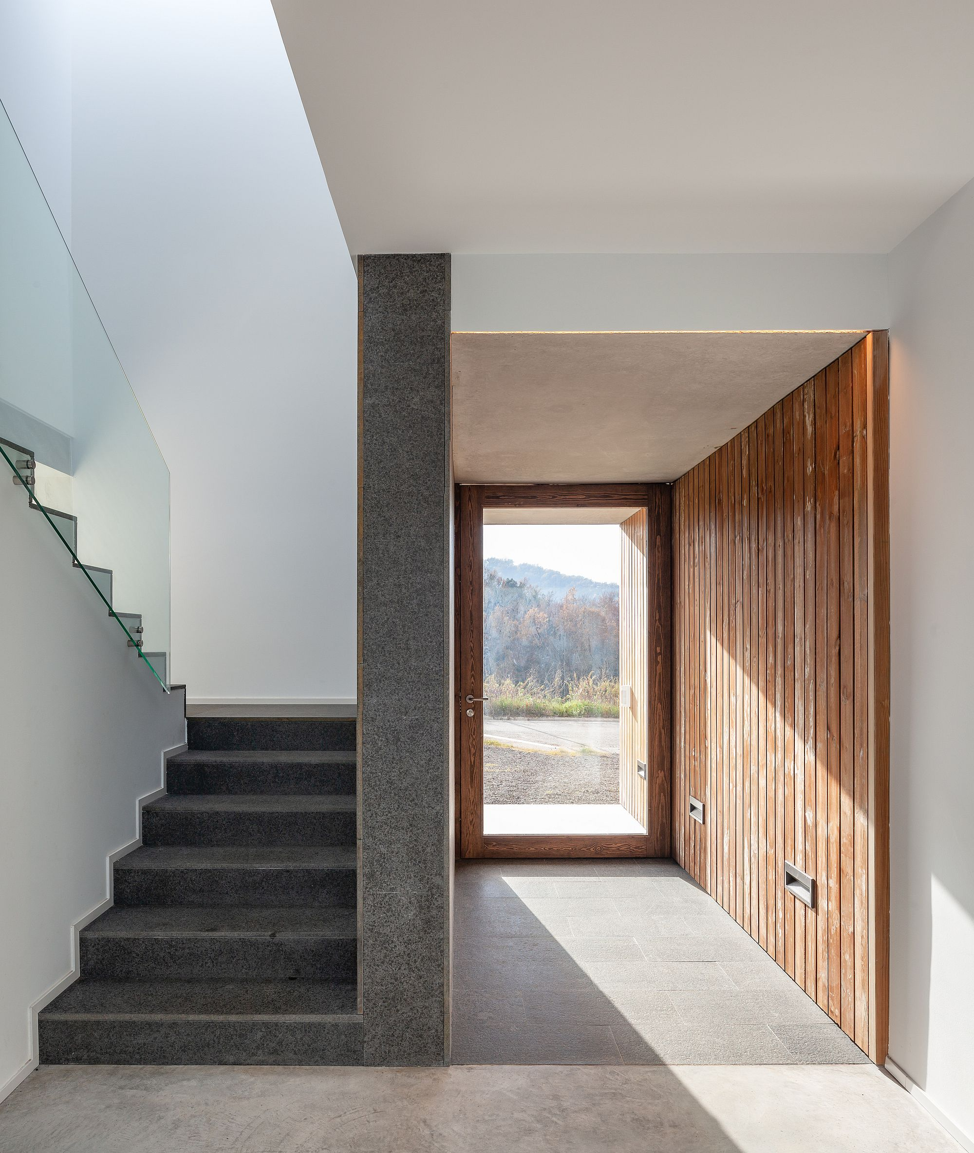 Minimal and modern entry to the home in Olot, Spain