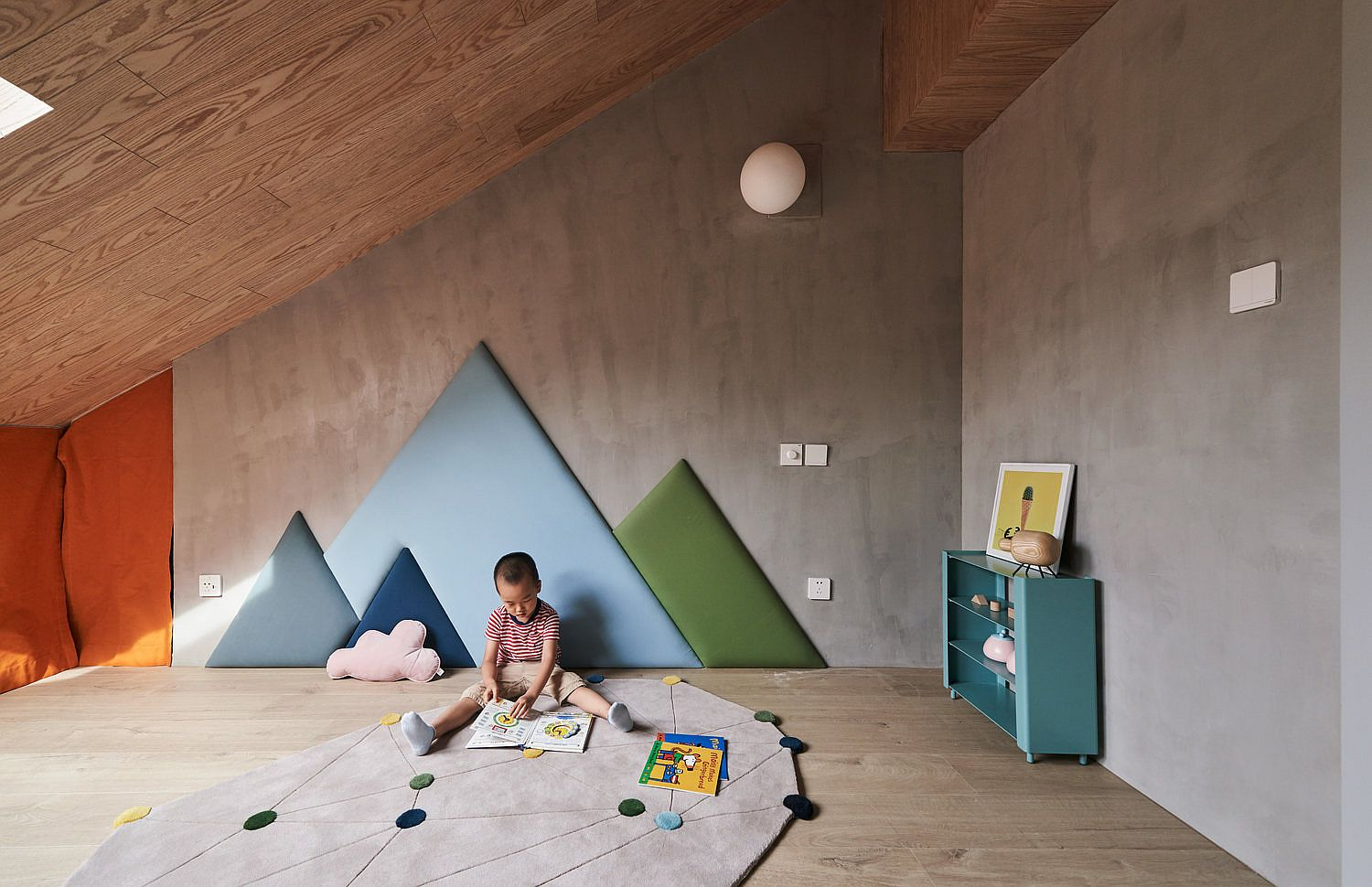 Minimal and modern kids' playroom with pops of bright color