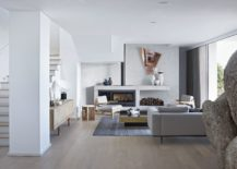 Minimal-living-room-in-white-with-a-giant-boulder-that-is-a-part-of-the-interior-217x155