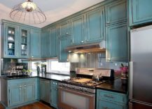 Mirrored-backsplash-in-this-traditional-kitchen-creates-the-perception-of-more-space-on-offer-217x155