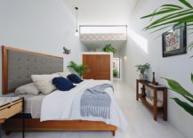 Modern-bedroom-in-white-with-wooden-accents-and-art-work-from-Pablo-Picasso-217x155