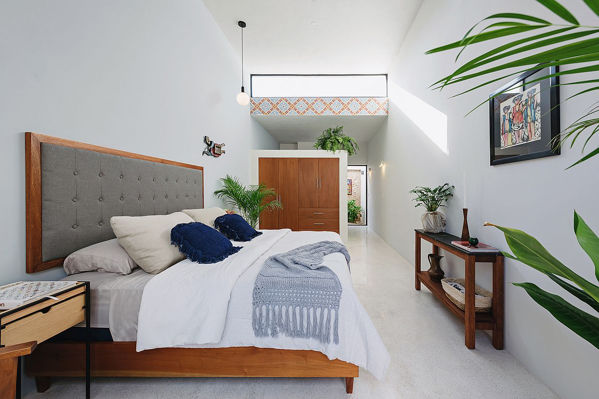 Modern-bedroom-in-white-with-wooden-accents-and-art-work-from-Pablo-Picasso