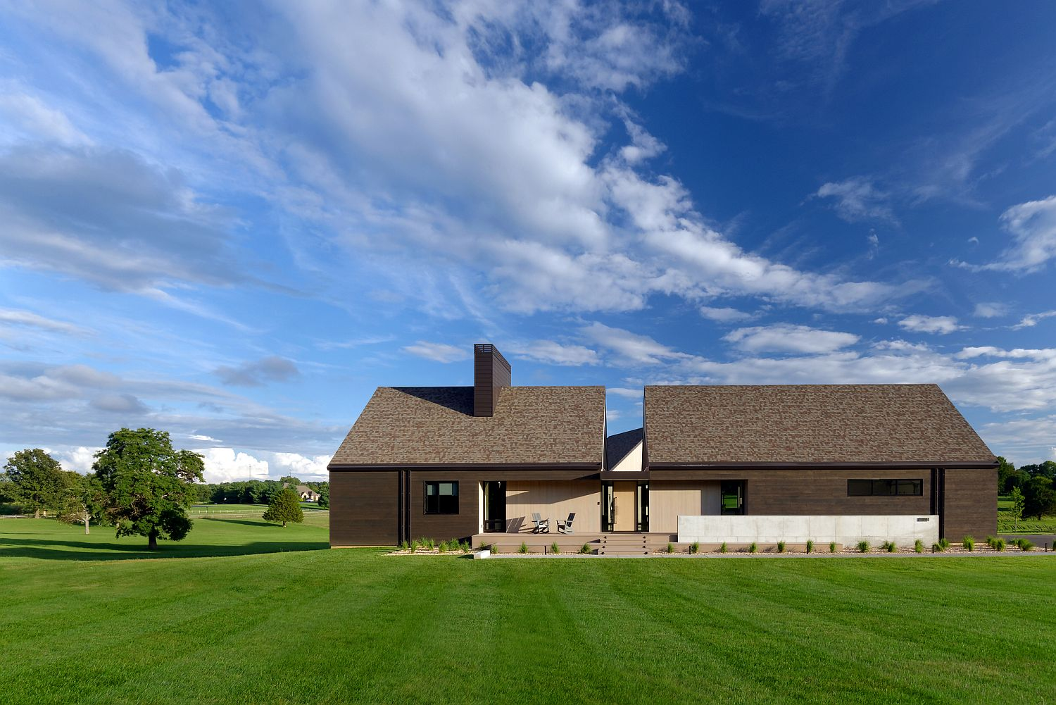 Modern classic house in Rogersville clad in different types of cedar